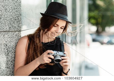 Tourist Looks At The Photos Shot With The Digital Camera.