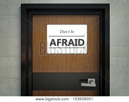 Dont Be Afraid Sign Hanging On A Office Door
