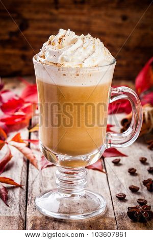 Pumpkin Latte With Whipped Cream In A Glass Jar