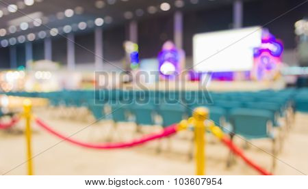 Blurred Image Of Auditorium And Stage In Hall