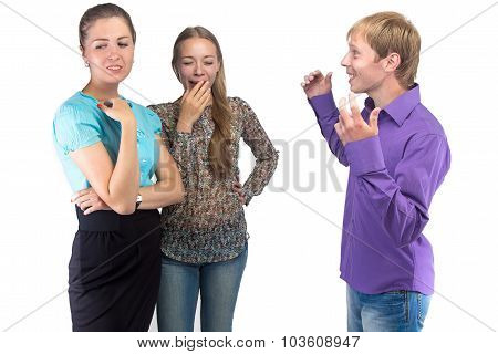 Talking Young Man And Two Women