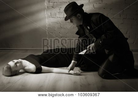 Detective Investigating The Crime Scene