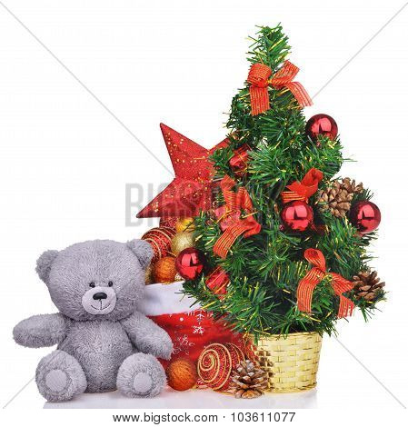 Composition With Teddy Bear Christmas Tree And Santa Claus Bag