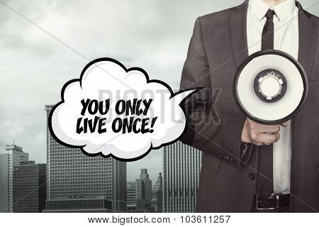 You only live once text on speech bubble with businessman and megaphone