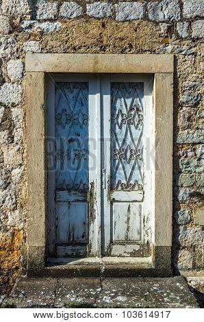 White Wooden Door In Old House