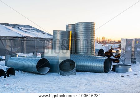 Ventilation Pipes On Site At Winter Evening
