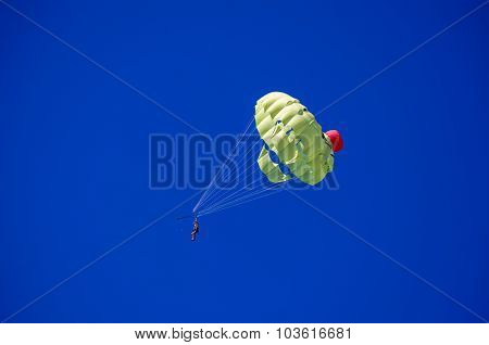 People On Parachute In The Blue Sky