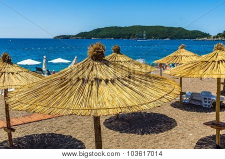 Umbrellas And Loungers On The Beach
