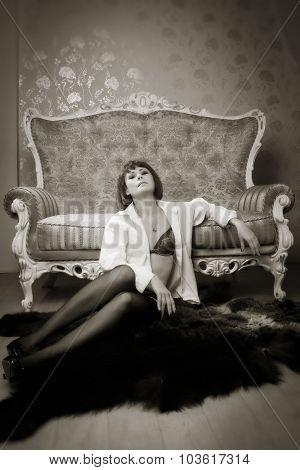 Attractive Woman Posing On A Luxurious Couch