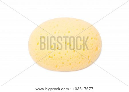 Round Yellow Natural Facial Cellulose Sponge Isolated On White Background.