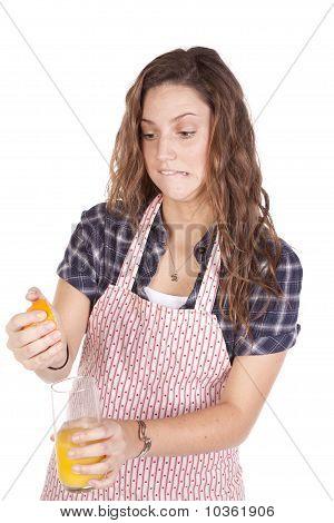 Woman Squeezing Orange Juice Hard