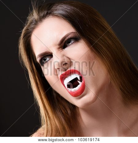 Halloween idea Lady Vampire Style. Brunette Woman close-up Portrait