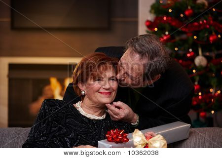 Senior Woman Getting Christmas Present