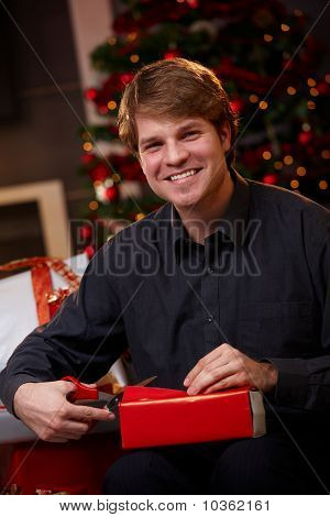 Happy Man Wrapping Christmas Presents