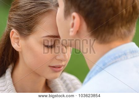 Pleasant couple kissing