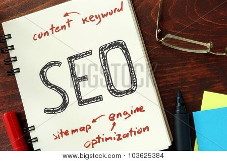 SEO (search engine optimization) written in the notepad.