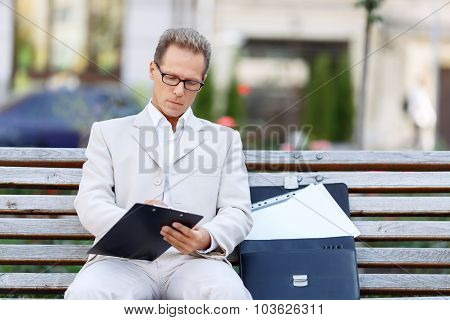 Handsome man sitting on the bench