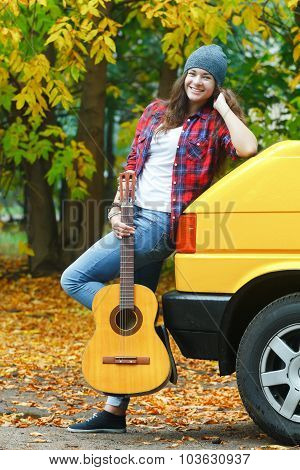 Fall Time Full Length Portrait Of Cheerful Guitarist Girl Travelling By Yellow Van