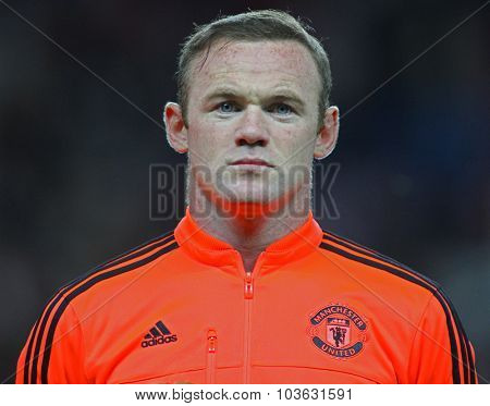 MANCHESTER, ENGLAND - SEPTEMBER 30, 2015: Wayne Rooney looks on prior the Champions League match between Manchester United and Vfl Wolfsburg at Old Trafford Stadium on September 30, 2015