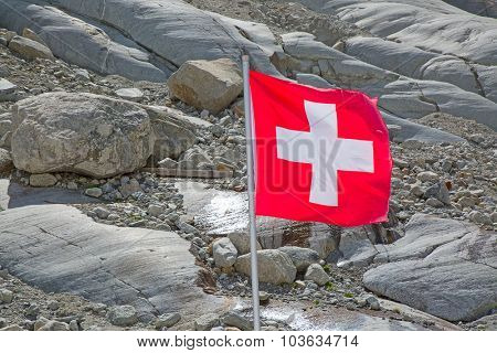 Swiss flag against rocky background