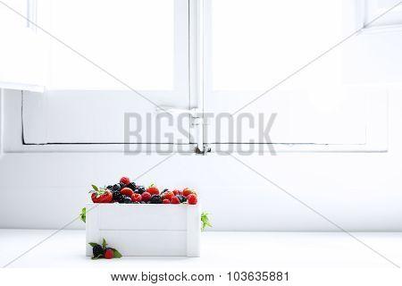 Berries Raspberries Blueberries Strawberries And Blackberries In A White Box Near The Window In Morn