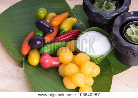 Special Thai Dessert on banana leaf wood background.