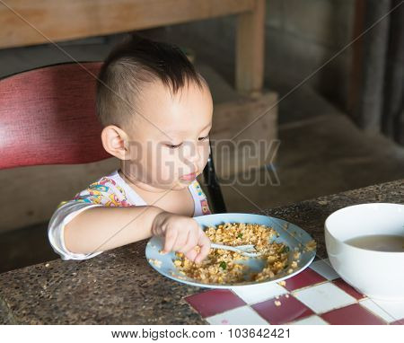 Thai Baby Eating Fried Rice  By Self