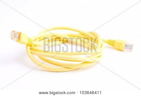 Yellow Network Cable with molded RJ45 plug isolated against white background
