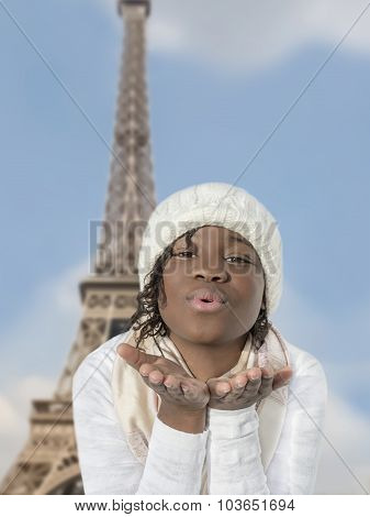 Afro girl sending a kiss from Paris
