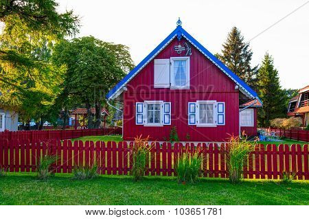 Traditional Lithuanian wooden house in the countryside. Pervalka village, Lithuania.