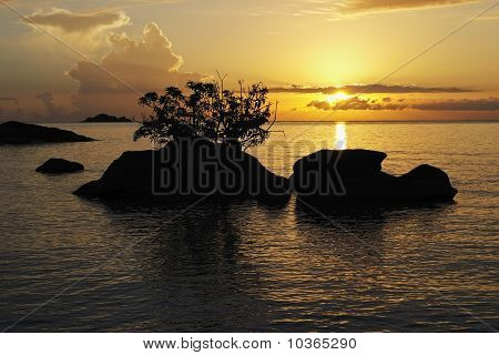 Sunrise With Sihouetted Rocks, Makuzi Beach, Malawi.