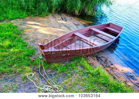 Wooden boat at the riverbank