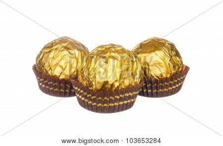 Chocolate Balls Wraped With Golden Foil Isolated On White