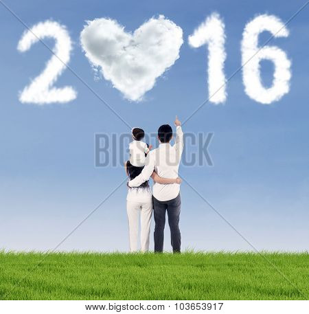 Happy Family Looking At Numbers 2016