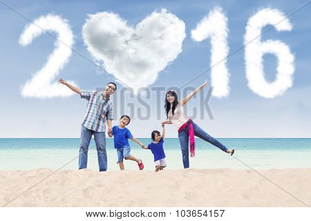 Happy Family On Beach With Numbers 2016