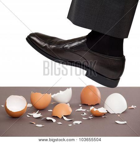 Man walking on egg shells