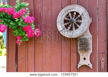 Old wooden spindle on the painted wall