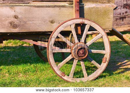 Wooden wheel of the old cart