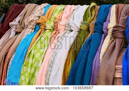 Colorful linen scarfs hanged on the bar