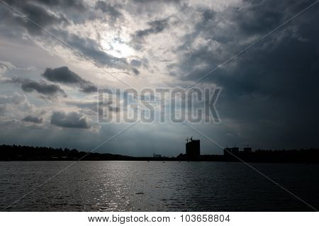 Dark cloudy evening view of Lakeshore area with few new skyscrapers constructions on the shoreside