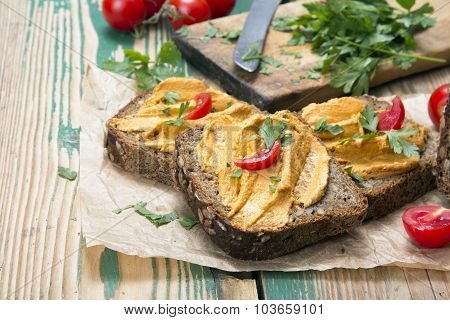 sandwich with tomato pate and chopped parsley