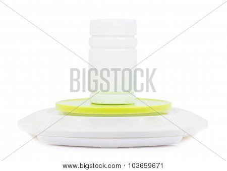 Empty bottle stands on electronic scales.