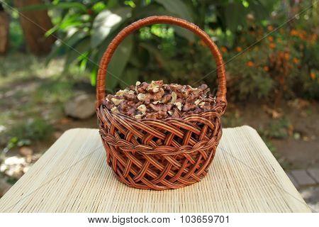 Kernels Of Walnuts In A Wicker Basket From Vines