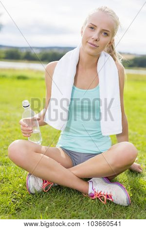 Smiling attractive woman taking break on the grass
