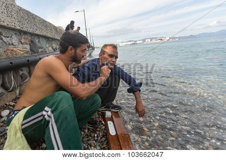 KOS, GREECE - SEP 27, 2015: Unidentified refugees. More than half are migrants from Syria, but there are refugees from other countries - Afghanistan, Pakistan, Iraq, Iran, Mali, Bangladesh, Eritrea.