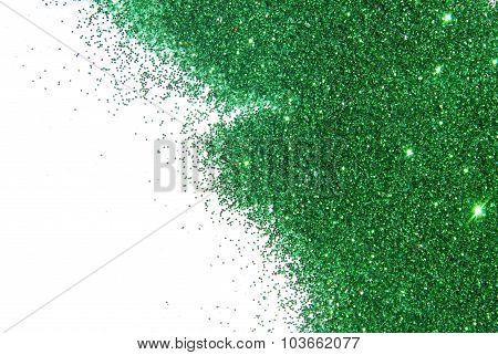 Green glitter sparkle on white background