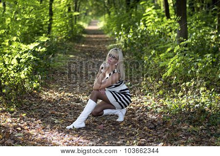 The Beautiful Woman Sat Down In The Autumn Wood, In The Middle Of A Footpath