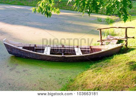 Wooden boat at the riverbank. Lithuania.