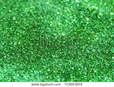 Blurry background of green glitter sparkle