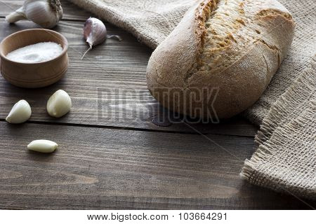 Garlic, Salt And A Loaf Of Bread
